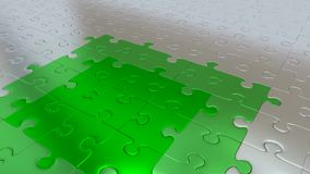 Silver Puzzle Pieces on all other the floor becoming Green piece. Some Silver Puzzle Pieces on all other the floor becoming Green pieces Royalty Free Stock Images