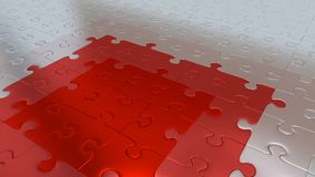 Silver Puzzle Pieces on all other the floor becoming Red pieces. Some Silver Puzzle Pieces on all other the floor becoming Red pieces Royalty Free Stock Photos
