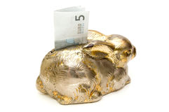 Silver rabbit savings bank with a five euro billet Royalty Free Stock Images