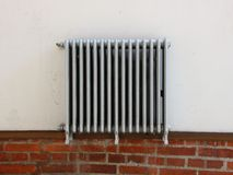 Silver Radiator Mounted on White Wall Royalty Free Stock Image