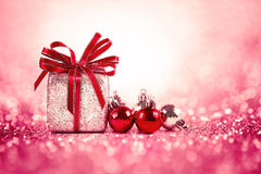 Silver and red Christmas balls and gifts on sweet red pink glitter lighting background stock photos