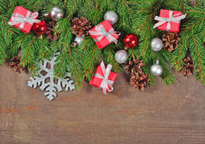 Silver and red Christmas decorations and spruce branch and cones Royalty Free Stock Photo
