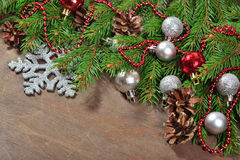 Silver and red Christmas decorations and spruce branch and cones Stock Image