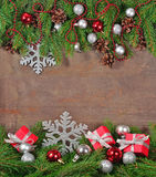Silver and red Christmas decorations and spruce branch and cones Stock Photos