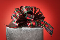 Silver and red Christmas gift Royalty Free Stock Photography