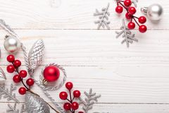 Silver and red christmas gifts on white wooden background. Top view. stock images