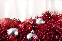Silver and Red Christmas Ornaments on Garland Stock Photography