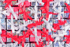 Silver and red gifts as background Stock Images