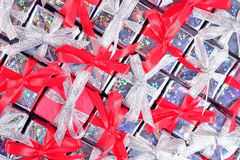 Silver and red gifts as background Royalty Free Stock Photos