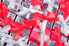 Silver and red gifts as background Royalty Free Stock Images