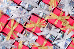 Silver and red gifts as background Stock Photography
