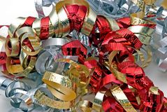 Silver, red and gold ribbon. Different colored ribbons used to adorn holiday gifts royalty free stock photos