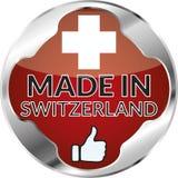 Round made in switzerland button. Silver red round made in switzerland button Stock Image