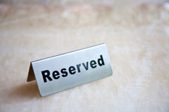Silver reserved plate. On the table Royalty Free Stock Photos