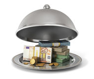 Silver Restaurant cloche with banknotes and coins Stock Photos