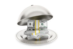 Silver Restaurant cloche with dollars banknotes Stock Photo