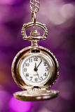 Silver retro clock on a festive purple background Royalty Free Stock Photos