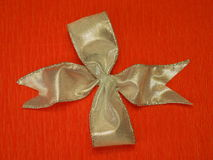 Silver ribbon. Isolated on orange background Royalty Free Stock Image