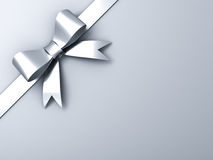 Silver ribbon bow on corner gray background Royalty Free Stock Images