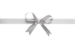 Silver ribbon with bow for packaging. Isolated on white Royalty Free Stock Photo
