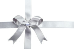 Silver ribbon with bow on white background. Stock Photography