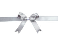 Silver ribbon with bow on white background. Stock Photo