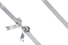 Silver ribbon with bow on white background. Stock Images