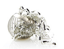 Silver Ribbon in Bowl on white background Royalty Free Stock Photos