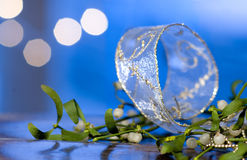 Silver ribbon and mistletoe Royalty Free Stock Photo