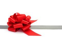 Silver ribbon and red ribbon bow Royalty Free Stock Photos