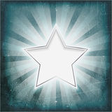 Silver rimmed star on aged light rays parchment. Vintage wintry light rays background glowing silver rimmed center star. Grunge elements give it a textured and Royalty Free Stock Photos