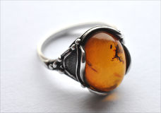 Silver ring and amber Stock Photos