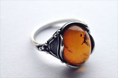 Silver ring and amber Royalty Free Stock Images