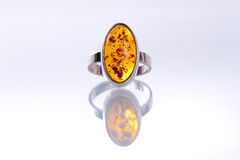 Silver ring with amber stone Royalty Free Stock Photography