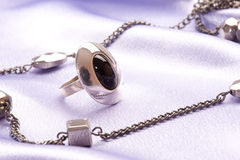 Silver ring and beads Stock Photo