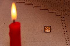 Silver ring and burning candle royalty free stock photos
