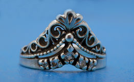 Silver ring with a crown Royalty Free Stock Images