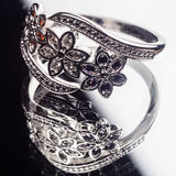Silver Ring decorated with precious stones sapphire, zirconia, ruby Stock Image