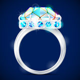 Silver ring with diamond against dark background Stock Photography