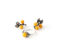 Silver ring and ear-rings with. Little beautiful silver ring and ear-rings with yellow stones Stock Photography