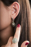Silver ring and earrings with emerald Stock Images