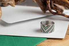 Silver ring with emerald Royalty Free Stock Images