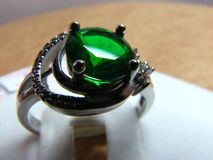 Silver ring with emerald stone royalty free stock photos
