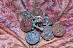 Silver ring. With gilding and the soldier with a bowl. Number of a coin and crosses. 17-18 centuries. Against the old dried-up maple leaf Royalty Free Stock Image