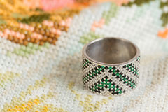Silver ring with green gemstone Royalty Free Stock Photo