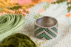 Silver ring with green gemstone Stock Photos