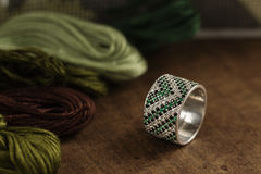 Silver ring with green gemstone Stock Photography