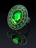 Silver ring with green (glass) stones. Stock Photography