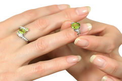 Silver ring with peridot on finger Stock Photo