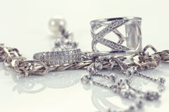 Silver ring with precious stones and fine silver chain Stock Photography